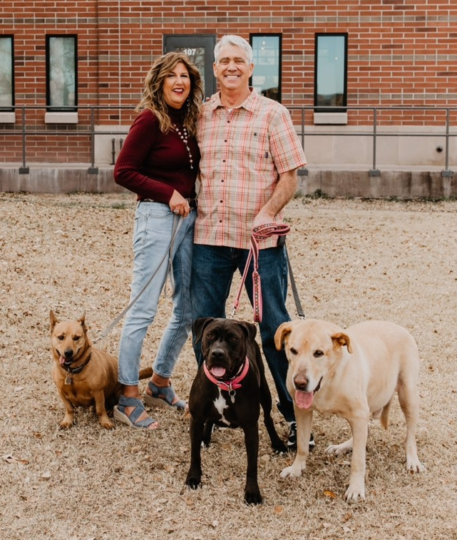 Marti Heck and her husband and dogs